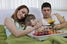 Free Happy Young Family Eat Breakfast In Bed Royalty Free Stock Image - 14944356