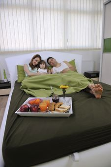 Free Happy Young Family Eat Breakfast In Bed Stock Photo - 14944430