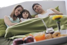 Free Happy Young Family Eat Breakfast In Bed Stock Photography - 14944432