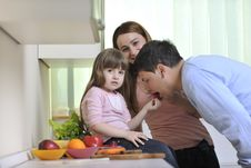 Free Happy Young Family In Kitchen Stock Images - 14944514