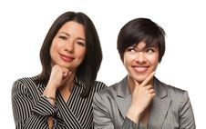 Multiethnic Mother And Daughter Portrait On White Stock Images