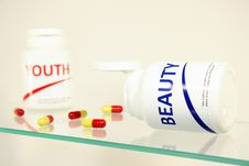 Free Beauty And Youth Pills In A Bottle Royalty Free Stock Images - 14944939