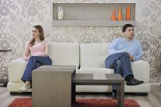 Couple Relax At Home On Sofa In Living Room Royalty Free Stock Image