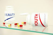 Free Youth And Beauty Pills In A Bottle Stock Photography - 14944982