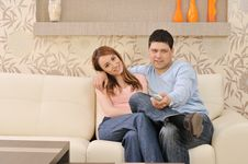 Couple Relax At Home On Sofa In Living Room Stock Photography