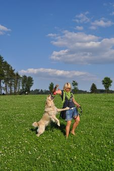 Free Woman Playing With Her Dog Royalty Free Stock Images - 14947139