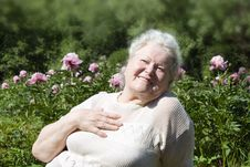 Senior Woman Enjoying The Summer Garden Royalty Free Stock Photo