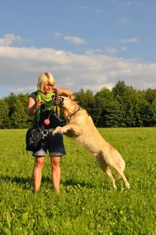 Free Woman Playing With Her Dog Royalty Free Stock Photos - 14948408