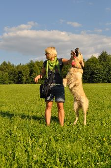 Free Woman Playing With Her Dog Stock Photography - 14948432