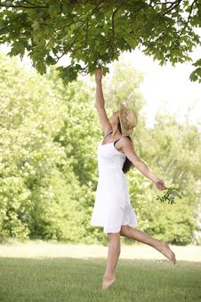 Free Woman Reaching Up To Branch Royalty Free Stock Photos - 14949038