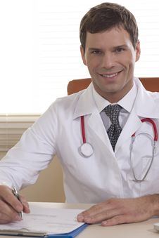 Male Doctor In His Office Stock Photos