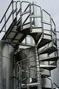 Free Chrome Circular Stairway & Wine Fermentation Tanks Stock Photography - 14950222