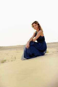 Free Beautiful Woman Sitting On The Beach In A Sand Royalty Free Stock Image - 14950046