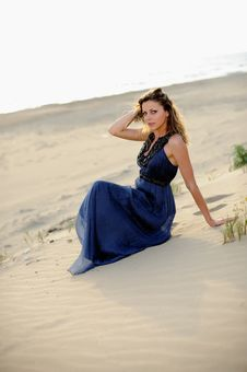 Free Beautiful Woman Sitting On The Beach In A Sand Royalty Free Stock Images - 14950059
