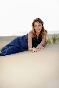 Free Beautiful Woman Sitting On The Beach In A Sand Stock Photo - 14950070