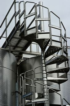 Free Chrome Circular Stairway & Wine Fermentation Tanks Stock Photography - 14950222