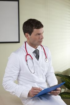 Free Male Doctor With Paperwork Stock Image - 14950271