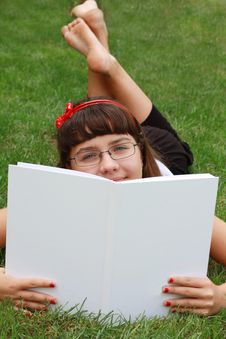 Free The Girl Wearing Spectacles Reads The Book Stock Photography - 14950692