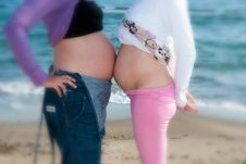 Pregnant Women And The Ocean Stock Photo