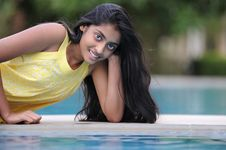 Free Girl Sitting At Pool Stock Images - 14954034