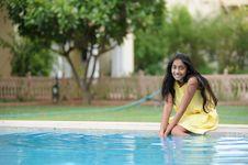 Free Girl Sitting At Pool Stock Photos - 14954313
