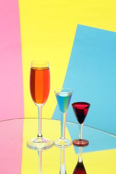 Free Three Wine-glasses On Multi-coloured Background Stock Image - 14954461