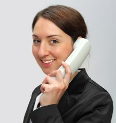 Woman Talking By The Phone Stock Images