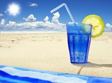 Free Glass Of Sparkling Water On A Beach Stock Photography - 14955202