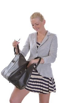 Young Woman With Opened Large Bag Royalty Free Stock Photography