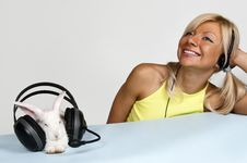 Free Blond And White Rabbit Listening To Music Royalty Free Stock Photo - 14959075