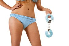 Free Pretty Girl Holding Handcuffs Royalty Free Stock Photo - 14959105