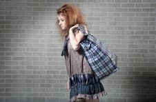 Free Tired Redhaired Woman With Shopping Bag. Royalty Free Stock Images - 14962029