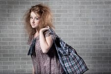 Free Tired Redhaired Woman With Shopping Bag. Royalty Free Stock Image - 14962066