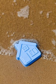 Free Plastic Toy House Lies On The Sand Stock Photos - 14963223