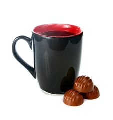 Free Coffee Is In A Black Cup And Chocolate Candies Stock Images - 14964454