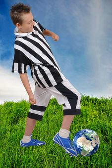 Free Young Footballer With Earth Ball On Grass Stock Images - 14965214