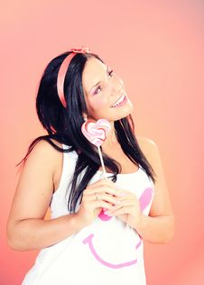 Free Teenage Girl With A Heart Shaped Lollipop Royalty Free Stock Image - 14965326