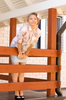 Girl Standing On A Veranda