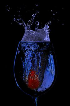 Free Strawberry Splash In A Glass Of Blue Water Stock Images - 14969414