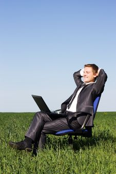 Free Young Businessman On A Green Field Royalty Free Stock Photo - 14969905