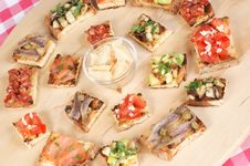 Free Various Italian Bruschetta Over A Cutting Board Stock Photography - 14969992