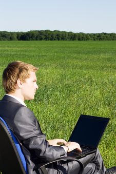 Free Businessman In The Field, With A Laptop Stock Photos - 14969993