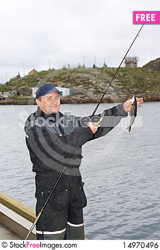 Free The Fisherman On The Pier On Island Skrova Royalty Free Stock Image - 14970496