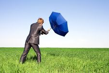Free Businessman Holding An Umbrella In A Storm. Stock Photo - 14970070
