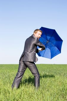 Free Business Man With An Open Umbrella.Protection Stock Image - 14970121