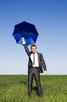 Conceptual Photo Of Businessman Flying On Umbrella Stock Photography