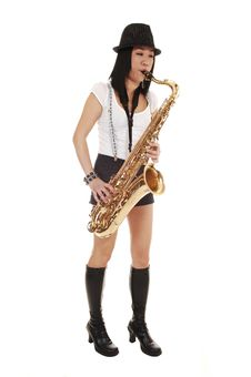 Chinese Girl Playing The Saxophone. Royalty Free Stock Image