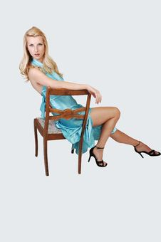 Free Tall Blond Girl Sitting. Royalty Free Stock Image - 14970996