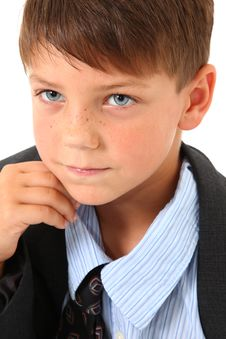 Adorable Boy In Over Sized Suit Royalty Free Stock Photo