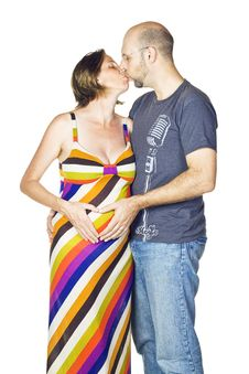 Beautiful Pregnant Couple In Love And  Kissing Stock Photo